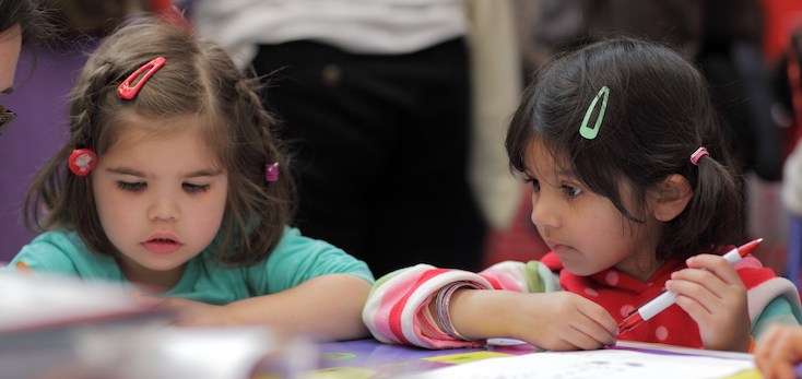 Photograph of two girls at the Cambridge Science Festival